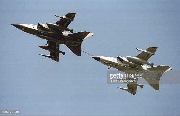 The refuelling of an ECRTornado fighter plane by a Tornado refueller