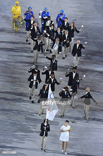 The Refugee Olympic team members take part in the opening ceremony of the Rio 2016 Olympic Games at the Maracana stadium in Rio de Janeiro on August...