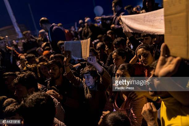 The refugees stage a protest along the railway at the camp on the GreekMacedonian border in Idomeni against the closed borders of Macedonia There are...