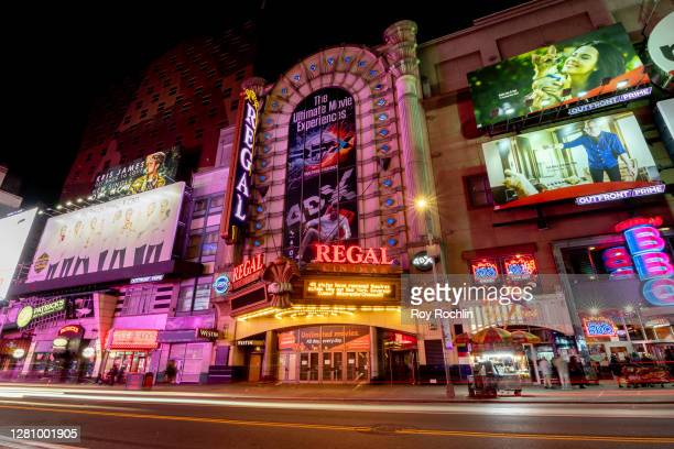 """The Regal Cinema marquee in Times Square reads, """"48 states have reopened theaters safely. Why not New York, Governor Cuomo? #ReopenOurCinemasNY"""" on..."""
