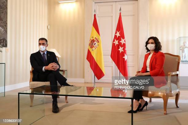 The regional president of Madrid Isabel Diaz Ayuso poses with Spanish Prime Minister Pedro Sanchez prior to holding a meeting for emergency talks to...