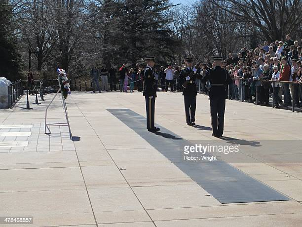 The regular changing of the guard ceremony at the Tomb of the Unknowns in Arlington National Cemetery, Virginia. The tomb contains the bodies of...