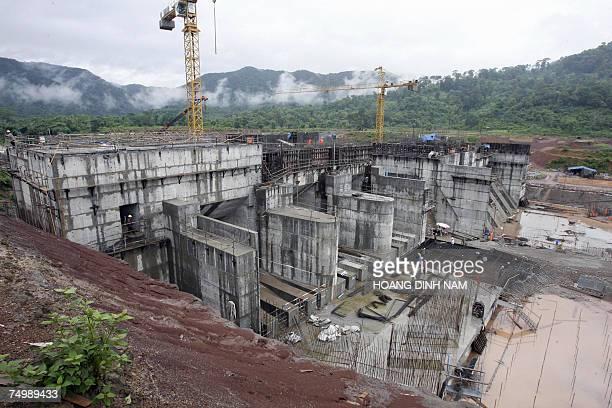 TO GO WITH STORY LAOSECONOMYENVIRONMENTDAM The regulating dam of the Nam Theun 2 power dam under construction is pictured 28 June 2007 in Laos' Nakai...