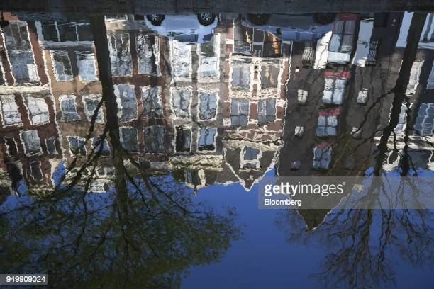The Reguliersgracht canal reflects houses and blue sky in Amsterdam Netherlands on Friday April 20 2018 Brexit will lead as many as 30 significant...