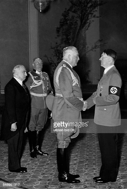 The Reich Protector of Bohemia and Moravia Konstantin von Neurath congratulating Adolf Hitler in the Reich Chancellery in Berlin President of the...