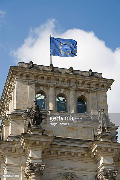 the reichstag building in berlin with europe flag - hugh threlfall stock pictures, royalty-free photos & images