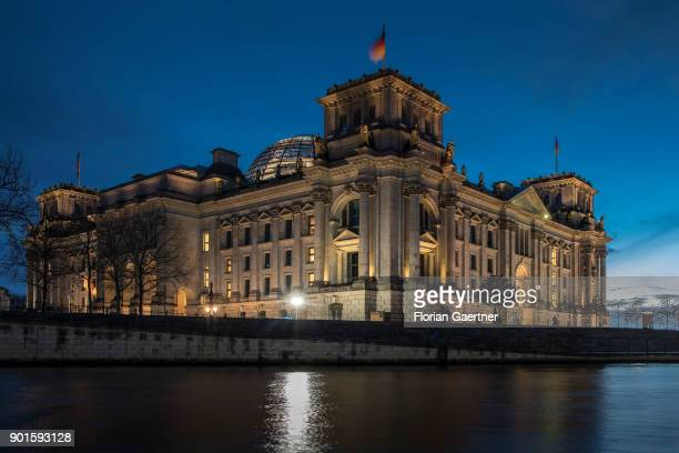 The Reichstag building is pictured during the blue hour on January 05 2018 in Berlin Germany