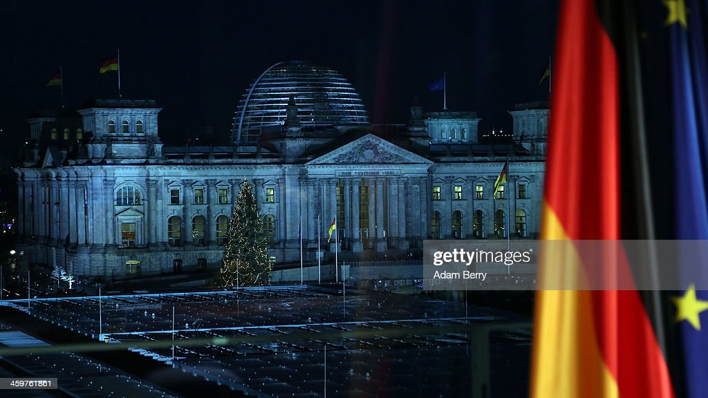 The Reichstag building is seen out of a television studio window prior to the recording of German Chancellor Angela Merkel's New Year's television address to the nation at the federal chancellery (Bundeskanzleramt) on December 30, 2013 in Berlin, Germany.
