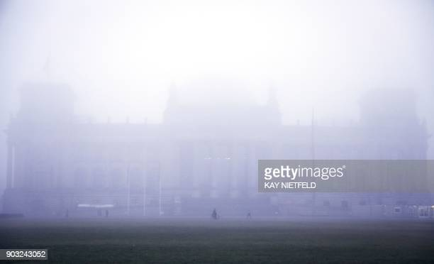 The Reichstag building that houses the lower house of Parliament 'Bundestag' is fog covered in Berlin on January 10 2018 / AFP PHOTO / dpa / Kay...