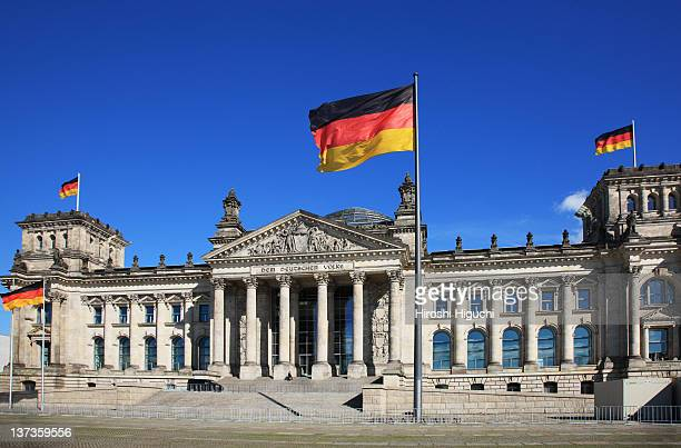 the reichstag, german parliament building - german flag stock pictures, royalty-free photos & images