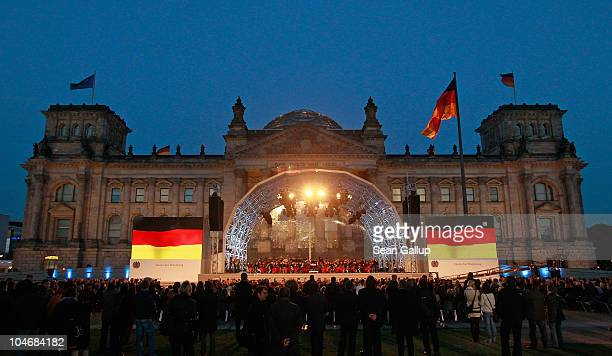 The Reichstag seat of Germany's federal parliament stands illuminated during celebrations marking the 20th anniversary of German reunification on...