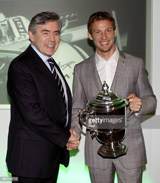 The reigning Formula One Champion Jenson Button poses for photographs with Britain's Prime Minister Gordon Brown after Button received the Richard...