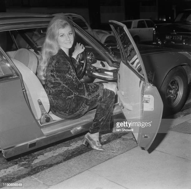 The reigning Miss World Penelope Plummer of Australia in the driver's seat of a special edition blue Jensen Interceptor MK I which she has been given...