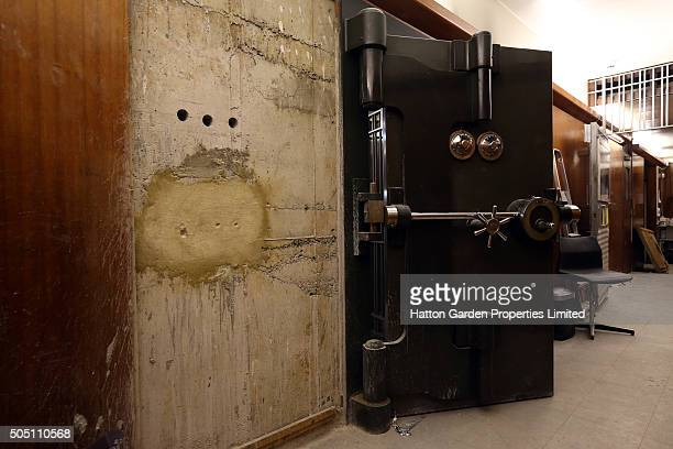 The reinforced steel door and the sealed hole that had been cut through the 50cm-thick concrete wall are pictured in the underground vault of the...