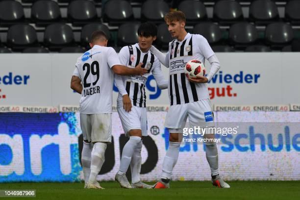 The rejoicing of Michael Lageder of Juniors OOe Inpyo Oh of Juniors OOe and Marko Raguz of Juniors OOe during the 2 Liga match between FC Juniors OOe...