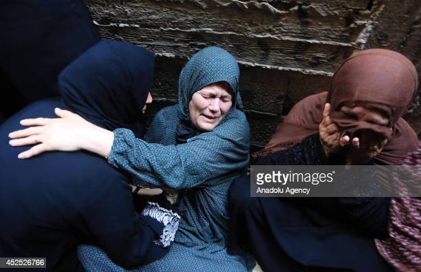 The relatives of Hassan Khader, killed by a Israeli rocket at the Shati refugee camp, mourn during the funeral ceremony in Gaza City, Gaza on July...
