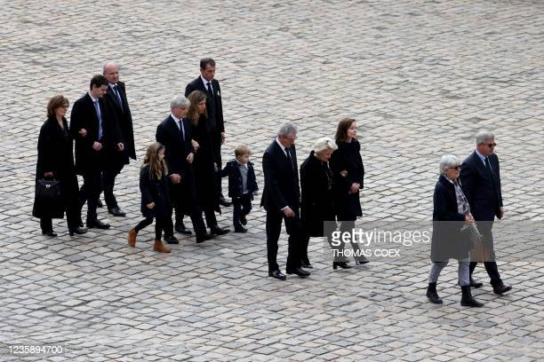 The relatives of Hubert Germain follow his coffin as they leave the national memorial service for him - the last surviving Liberation companion - at...