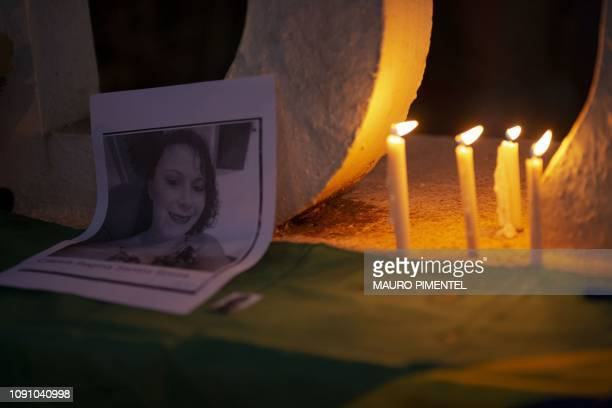 The relatives of victims and missing people hold a vigil at the entrance to the city of Brumadinho five days after the collapse of a dam at an...