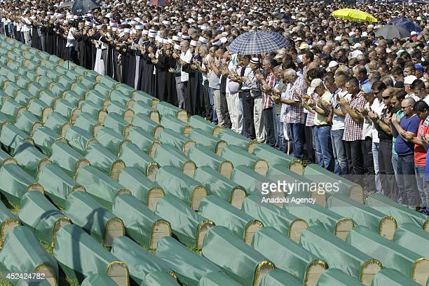 The relatives of victims pray during the funeral ceremony of 284 victims of Bosnian War who exhume from mass grave at Tomasica in Prijedor Bosnia and...