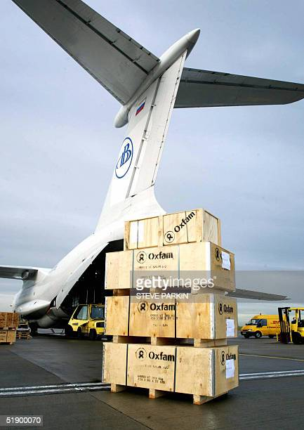 The relief agency Oxfam load supplies bound for Sri Lanka and Indonesia on to a cargo plane at East Midlands Airport near Nottingham England 29...