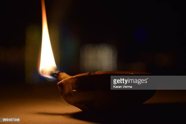 the religious macro - diya oil lamp stock pictures, royalty-free photos & images