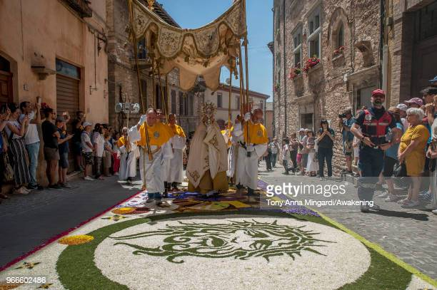 The religious procession of Corpus Domini takes place at INFIORATA on June 3 2018 in Spello Italy The 'INFIORATA' event has became a true tribute to...