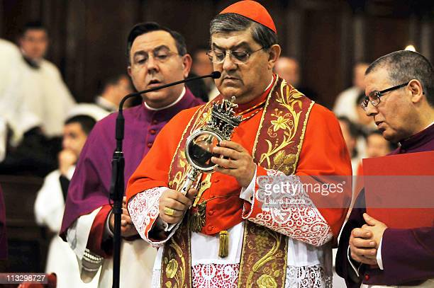 The reliquary containing the two vials of the blood of San Gennaro is carried by the Cardinal of Naples Crescenzio Sepe during a ceremony on the...
