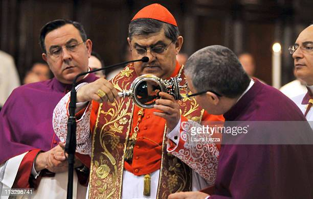 The reliquary containing the two vials of the blood of San Gennaro is carried and checked by the Cardinal of Naples Crescenzio Sepe during a...