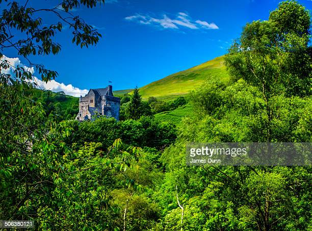 The remain of the ruin stands on a narrow ridge, on the Ochil Hills, overlooking Dollar, Clackmannanshire, Scotland Two ravines hem it in on either...
