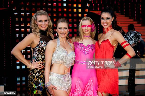 The remaining candidates Magdalena Brzeska, Stefanie Hertel, Joana Zimmer and Rebecca Mir pose for the photographers after 'Let's Dance' 8th Show at...