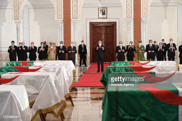 The remains of 24 of Algeria's independence fighters killed during the Algerian popular resistance against French colonialism brought by plane from...
