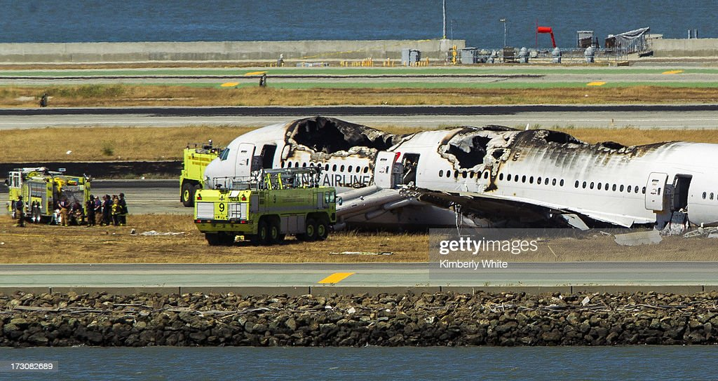 The remains of a Boeing 777 airplane lie on the tarmac after it crashed while landing at San Francisco International Airport July 6, 2013 in San Francisco, California. An Asiana Airlines passenger aircraft coming from Seoul, South Korea crashed while landing. There has been no official confirmation of casualties.