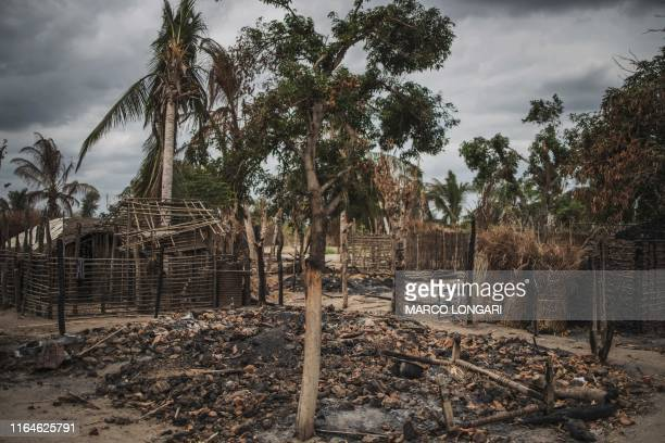 The remains of a burned and destroyed home is seen in the recently attacked village of Aldeia da Paz outside Macomia, on August 24, 2019. - On August...