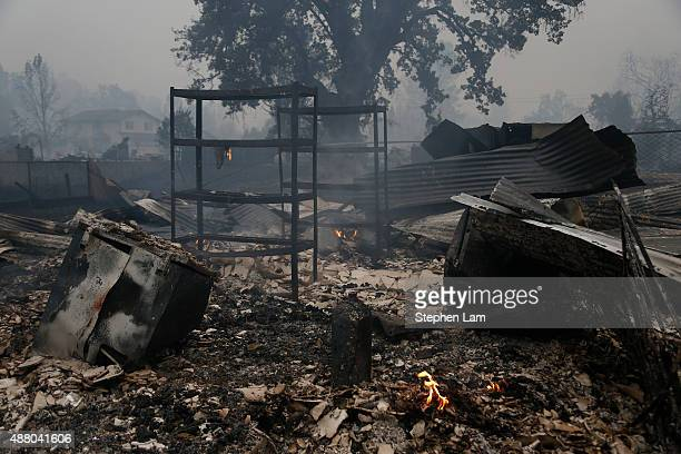 The remains of a burnt out building damaged by the Valley Fire are seen on September 13 2015 in Middletown California The fastmoving fire has...