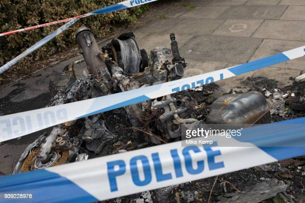 The remains of a burnt out motor scooter in London England United Kingdom Crime involving scooters and mopeds has increased in London but this crime...