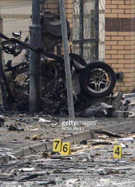The remains of a car bomb that exploded outside the Newtownhamilton Police station lies in a street in South Armagh Northern Ireland on April 23 2010...