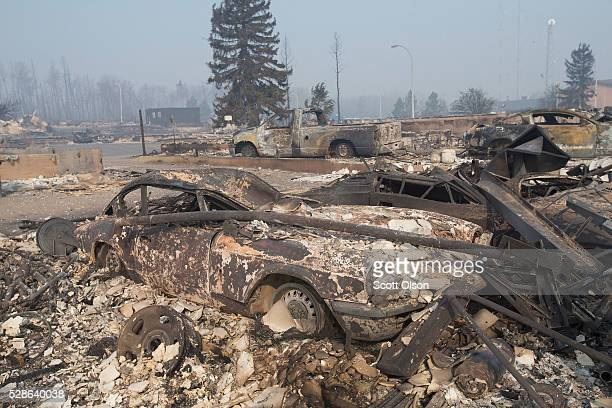 The remains of a classic Triumph GT6 sit in a residential neighborhood destroyed by a wildfire on May 6 2016 in Fort McMurray Alberta Canada...
