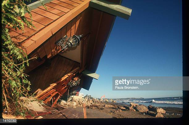 The remains of a collapsed home sit near the beach after an El Nino rainstorm February 9 1998 in Malibu CA Milliondollar homes sustain damage or are...