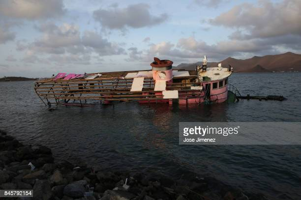 The remains of a destroyed boat float in Simpson Bay on September 11 2017 in St Maarten The Caribbean island sustained extensive damage from...