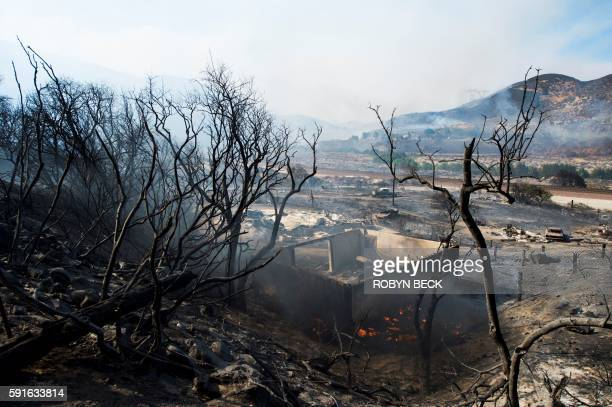 The remains of a destroyed home after the Blue Cut Fire passed through a rural community near Wrightwood California August 17 2016 / AFP / Robyn BECK