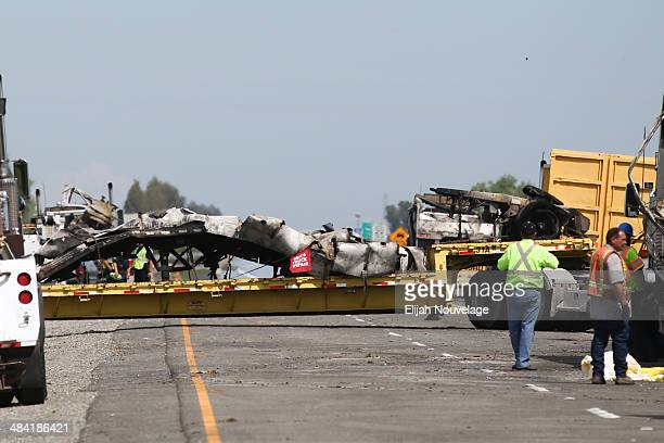The remains of a FedEx truck involved in Thursday's deadly crash is seen on a truck at the scene of the accident on April 11 2014 in Orland...