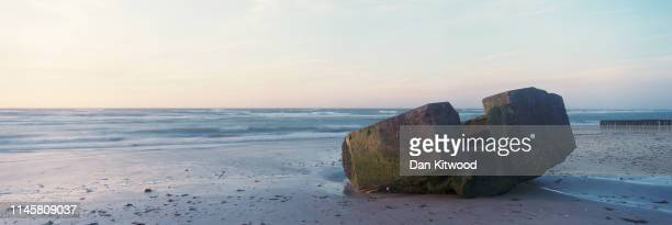 The remains of a German defense bunker along a section of what was known as 'Gold Beach' that would have been used during the June 6, 1944 D-Day...