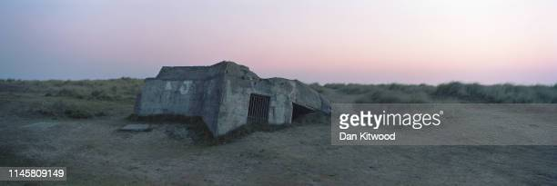 The remains of a German defense bunker on 'Juno Beach' that would have been used during the June 6, 1944 D-Day landings, on April 30, 2019 in...