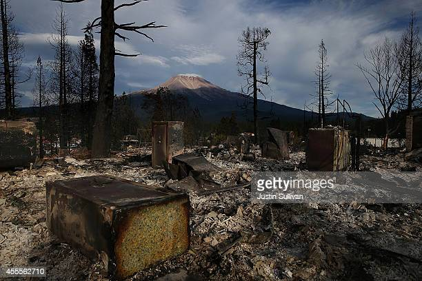 The remains of a home destroyed by the Boles Fire is shown in front of Mount Shasta on September 16 2014 in Weed California Fueled by high winds a...