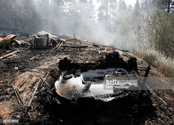 The remains of a home on Tuesday, September 18 that fell victim as the Karney Fire burned through Boise County, Idaho.