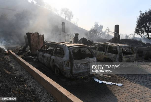 The remains of a house and cars left by the Thomas wildfire in Ventura California on December 5 2017 Firefighters battled a windwhipped brush fire in...