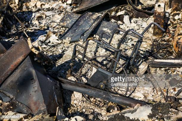 The remains of a house including a wheelchair can be seen after the Clayton Fire burned through Lower Lake California on August 16 2016 A man was...