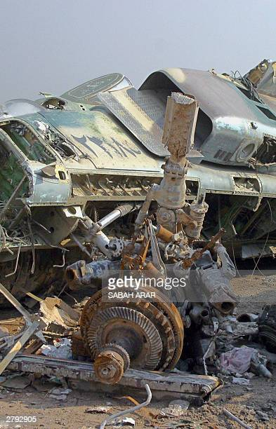 The remains of a jet turbine lies at a scrapyard 08 December 2003 in Sadr City a huge workingclass Shiite suburb of Baghdad The scrapyard contains...