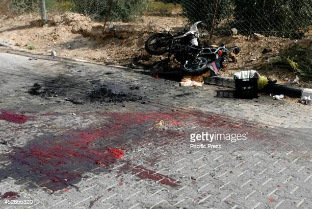 The remains of a motorcycle that was hit by an Israeli air strike in Khan Yunis in Southern Gaza Strip There were fifteen Palestinians killed today...