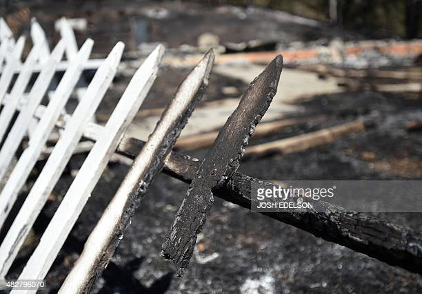 The remains of a picket fence surrounds a house burned down by the Rocky fire near Clear lake California on August 02 2015 Thousands of firefighters...